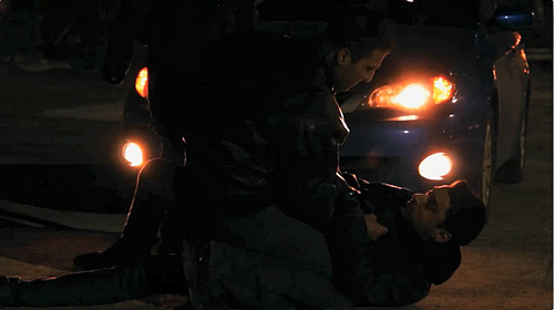 Car headlights light a scene